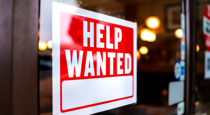 """Image shows a red and white """"Help Wanted"""" sign in a window. SmartAsset used BLS data to conduct its latest study on the fastest-growing and fastest-disappearing jobs in each state."""