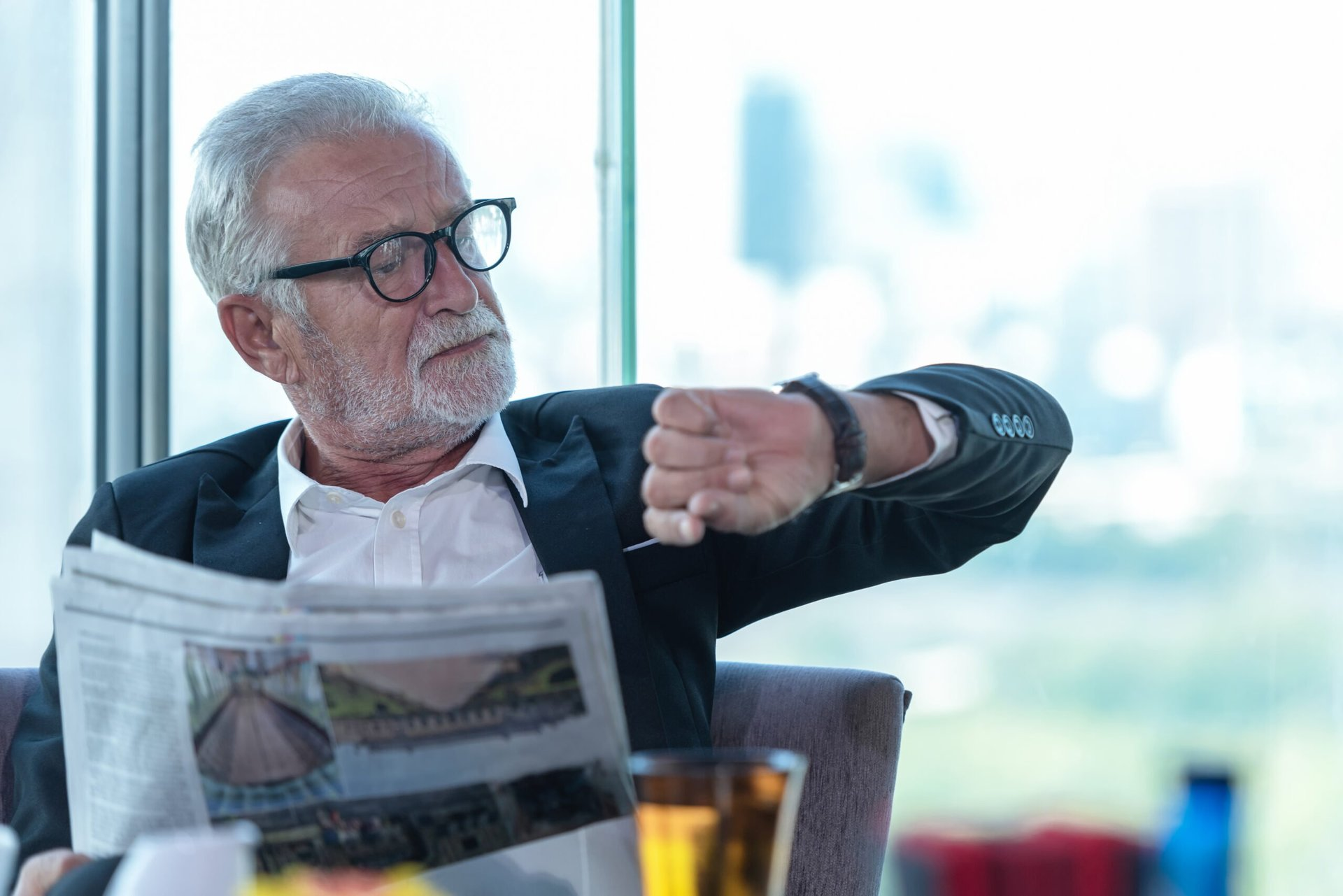 Retired man reading the newspaper