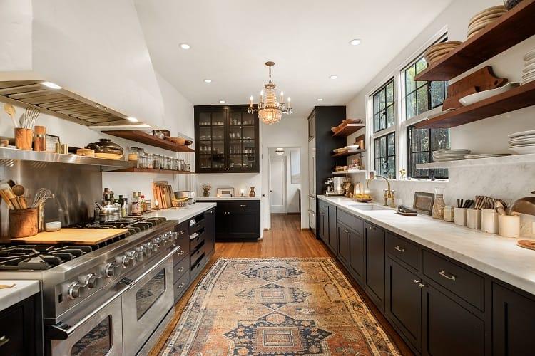 elegant kitchen with dark wood furniture and brass fixtures